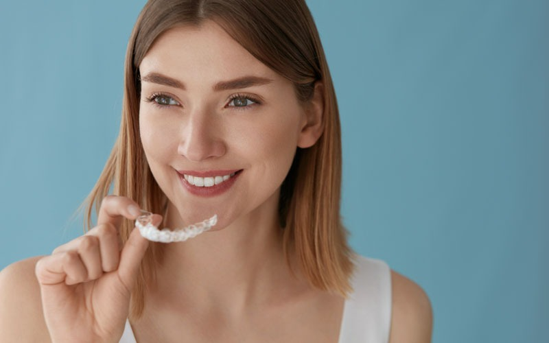 woman with clear aligners